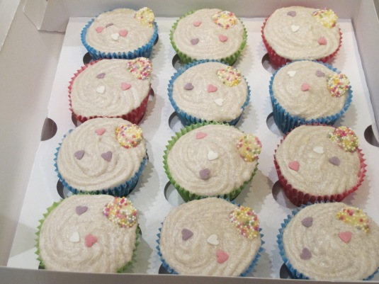 Old fashioned cupcakes topped with white chocolate jazzies