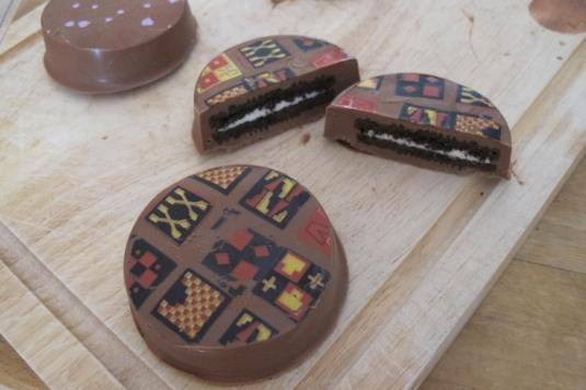 Chocolate Covered Oreos with chocolate transfer sheets
