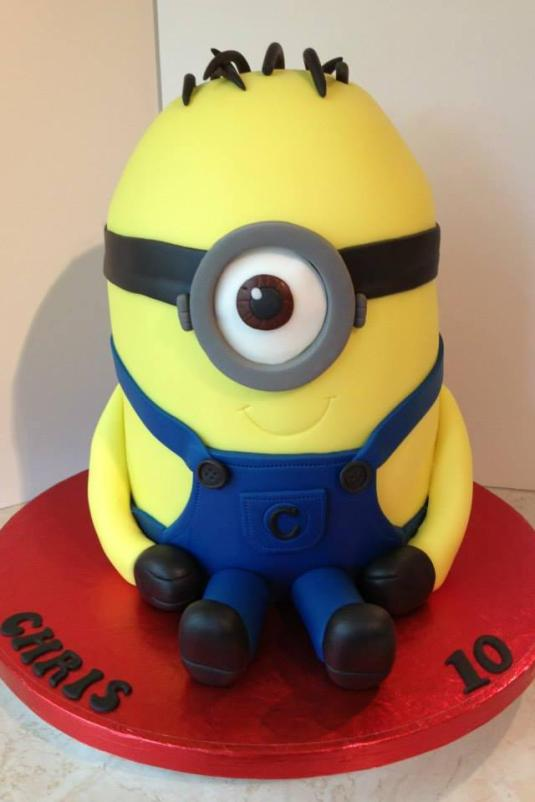 Minion cake made by Chloe Constantine. It has buttons made from our mould.
