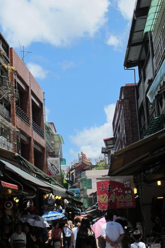 The street was lined on both sides with a variety of shops selling local  biscuits, candies, fruits, flowers, souvenirs and of course a huge  selection of ...
